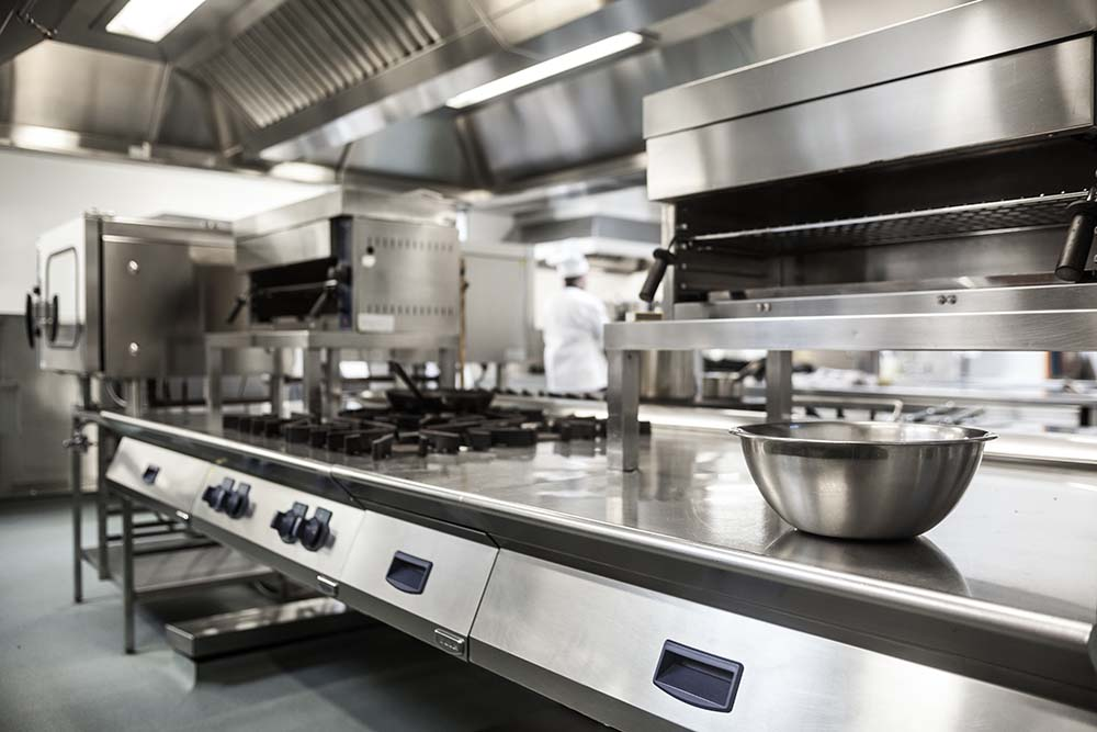 commercial kitchen with stainless steel kitchen fittings